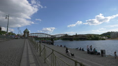 The Railway Bridge seen from Rasinovo Waterfront in Prague Stock Footage