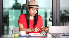 asian woman having a breakfast at a restaurant - stock footage