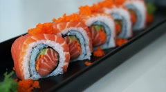 Video of salmon maki roll. Japanese sushi cuisine with fresh raw fish Stock Footage