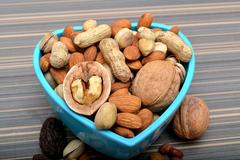 Set of Dry Fruits in a Bowl & around Stock Photos