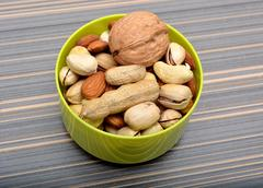 Set of Dry Fruits in Bowl with Peanuts & walnuts closeup Stock Photos