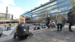 Punk youth relaxing at Sergels Torg in central Stockholm. Stock Footage