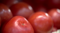 Red ripe tomatoes lie on a counter a close up Stock Footage
