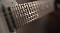 Guitar strings shiver on slow-motion shot Stock Footage