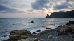Clouds float over the sea coast at sunset - stock footage