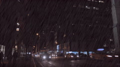 Traffic moves along New York's Fifth Ave. at night during a major rainstorm. Stock Footage