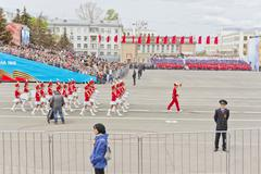 Women orchestra march at the parade on annual Victory Day - stock photo