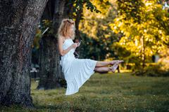 Girl levitates in nature Stock Photos