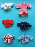 Colorful handmade puppet clothing - stock photo