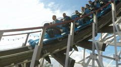 Slow Motion roller coaster at Gröna Lund amusement park in central Stockholm Stock Footage
