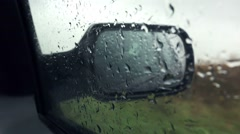 Car wing mirror on rainy day Stock Footage
