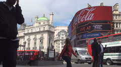 Sidewalk Street Traffic Piccadilly Circus Square Subway Red Buses London UK Stock Footage