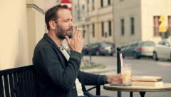 Young man smoking cigarette and drinking cocktail in bar R HD Arkistovideo