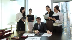 The head gives instructions to his secretaries Stock Footage