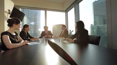 Young business partners meeting in modern office, sunlight from the window Stock Footage