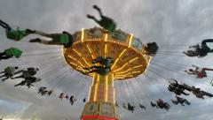 Wide angle of carousel at Gröna Lund amusement park in central Stockholm - stock footage