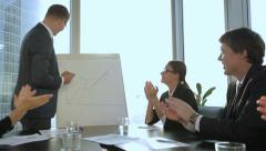 Young businessman making a presentation of a business plan in modern office in a Stock Footage