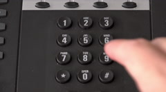 Dialing 911 on office phone 4k Stock Footage