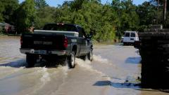 Cars flood waters crossing road away Stock Footage