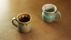 Preparing tea in two mugs, close up. Stock Footage