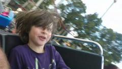 5 year old boy on ride at Gröna Lund amusement park in central Stockholm Stock Footage