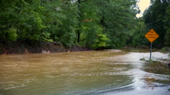 Flooded road with road sign Stock Footage