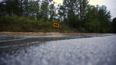 Flooded road from hurricane low shot Stock Footage