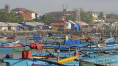 Boat returning to harbour between many boats,Pangandaran,Java,Indonesia Stock Footage