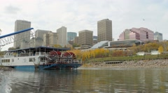 Edmonton Queen Riverboat with Louise Mckinney Park and skyline in background. Stock Footage