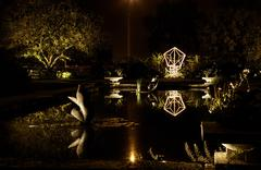 A reflecting pool in a garden at night Stock Photos