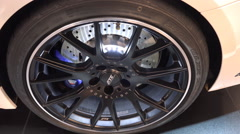 Super sports car wheel and rim close up tilt Stock Footage