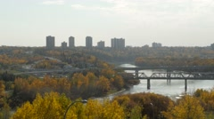 Edmonton's Walterdale Bridge and river valley in fall Stock Footage