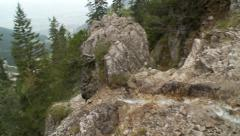 Bavarian Alps mountain waterfall streams down a valley, pan left Stock Footage