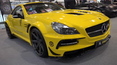 Mercedes SL yellow sports car at motorshow dolly Stock Footage