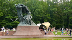 Monument of Frederic Chopin in Lazienki Park. Largest park in Warsaw, Poland Stock Footage