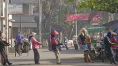 People pulling fisher net from sea on street,Pangandaran,Java,Indonesia Stock Footage