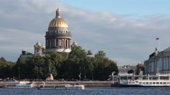 The Isaac Cathedral building is on the Admiralty embankment with moored ships Stock Footage