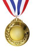 Closeup of golden medal on plain background Stock Photos