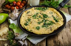 Frittata with spinach and garlic - stock photo