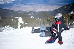 snowboarder against panoramic winter mountains - stock photo