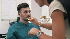 Model is geting ready fow photoset by stylist at the barber shop, slow motion Stock Footage