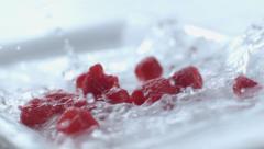 Raspberries splashing in slow motion; shot on Phantom Flex 4K at 1000 fps - stock footage