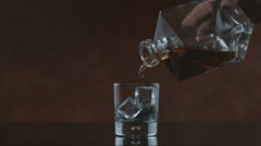 Whisky is poured into glass in slow motion; shot on Phantom Flex 4K at 1000 fps Stock Footage