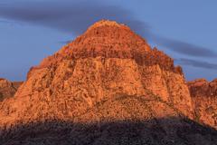 Warm Dawn Light on Rainbow Peak at Red Rock National Conservatio - stock photo