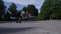 One on one street basketball; player shoots basket Stock Footage