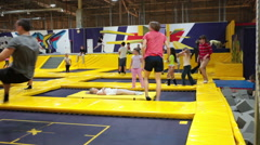 Trampolines are in the jumping club with having fun small children Stock Footage