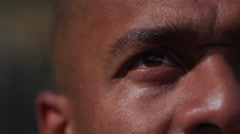 One on one street basketball; extreme closeup of players eye Stock Footage