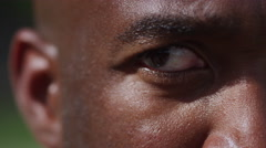 One on one street basketball; extreme closeup of players eye looking Stock Footage