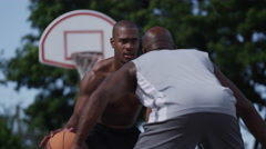 One on one street basketball; dribbling and gaurding Stock Footage
