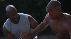 One on one street basketball; dribbling and defense Stock Footage